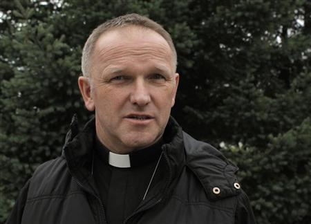 Polish priest Wojciech Lemanski talks as he poses for a picture in Jasienica near Warsaw July 16, 2013. REUTERS/Kacper Pempel