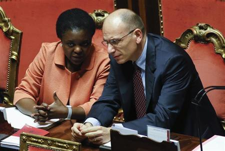 Italy's Prime Minister Enrico Letta (R) talks with Minister for integration Cecile Kyenge during a vote session at the Senate in Rome July 19, 2013. REUTERS/Remo Casilli