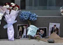Flowers and photos are left at a small memorial for Canadian actor Cory Monteith outside a downtown hotel in Vancouver, British Columbia July 15, 2013. REUTERS/Andy Clark