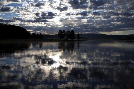 The sunrise is reflected in the Yellowstone River in Yellowstone National Park, Wyoming, June 24, 2011. REUTERS/Jim Urquhart