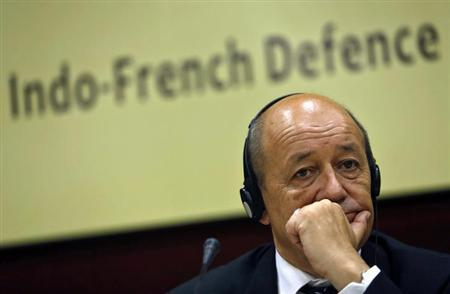 French Defence Minister Jean-Yves Le Drian listens to a reporter's question before addressing a gathering at the Institute for Defence Studies and Analyses (IDSA) in New Delhi July 26, 2013. REUTERS/Anindito Mukherjee