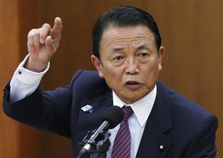 Japan's Finance Minister Taro Aso speaks during a semi-annual parliament hearing on monetary policy at the Lower House of the parliament in Tokyo June 19, 2013 file photo. REUTERS/Issei Kato