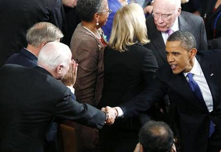 U.S. President Barack Obama (R) shakes hands with U.S. Sen. John McCain (R-AZ) as he arrives to deliver his State of the Union Speech on Capitol Hill in Washington, February 12, 2013. REUTERS/Jason Reed