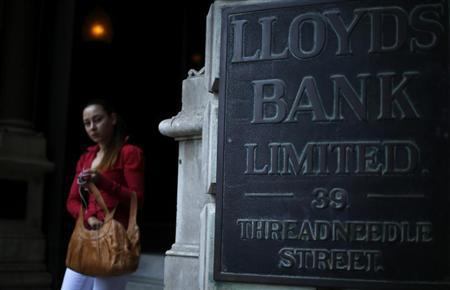 A woman leaves a branch of Lloyds Bank in the City of London August 1, 2013. REUTERS/Andrew Winning