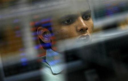 A broker reacts while trading at a stock brokerage firm in Mumbai February 11, 2008. REUTERS/Arko Datta/Files