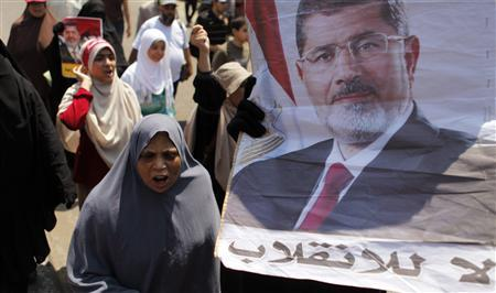 Members of the Muslim Brotherhood and supporters of deposed Egyptian President Mohamed Mursi shout slogans in Shubra, as they march towards Adawiya Square in the Nasr city area, east of Cairo, where they are camping, August 2, 2013. REUTERS/Amr Abdallah Dalsh