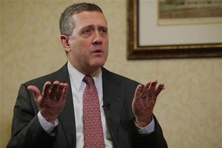 James Bullard, President of the St. Louis Federal Reserve Bank, speaks during an interview with Reuters in Boston, Massachusetts August 2, 2013. Bullard said on Friday that the U.S. economy is improving modestly but needs to gather more steam, while inflation remained too low for comfort, underscoring the debate within the central bank over when to scale back stimulus. REUTERS/Brian Snyder