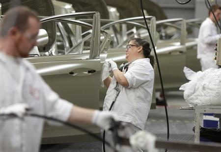 Michelle Arthur is seen working on the sealer line in the paint department during a tour of the Honda automobile plant in Marysville, Ohio October 11, 2012. REUTERS/Paul Vernon