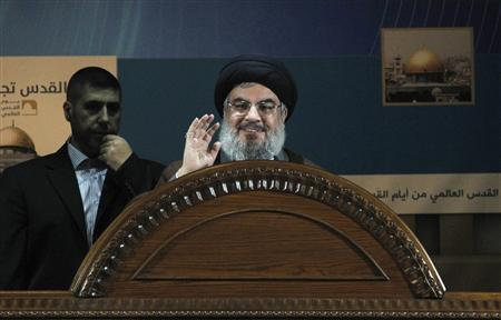 Lebanon's Hezbollah leader Sayyed Hassan Nasrallah makes a rare public appearance as he addresses his supporters during a rally to mark 'Quds (Jerusalem) Day' in Beirut's southern suburbs, August 2, 2013. REUTERS/Sharif Karim