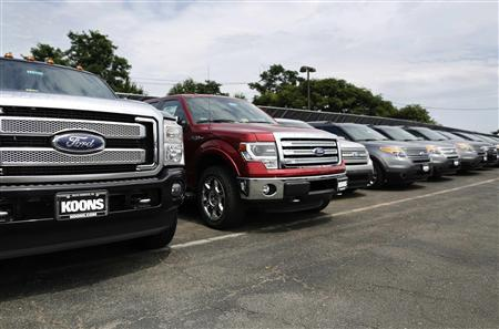 New Ford vehicles occupy the lot at Koons Ford dealership in Fairfax, Virginia, in this July 24, 2013 file photo. REUTERS/Jonathan Ernst/Files