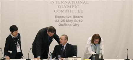 International Olympic Committee President Jacques Rogge (2nd from R) talks with the coordinator for the 2016 Olympics of Rio de Janeiro Richard L. Carrion (2nd from L) prior to the beginning of the IOC executive board meeting at the SportAccord convention at the Congress Center in Quebec City, May 24, 2012. REUTERS/Mathieu Belanger