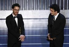 "Ethan (L) and Joel Coen accept the Oscar for best screenplay for ""No Country for Old Men"" during the 80th annual Academy Awards, the Oscars, in Hollywood February 24, 2008. REUTERS/Gary Hershorn"