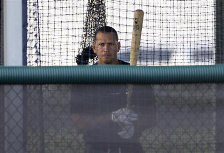 New York Yankees' Alex Rodriguez stands in the batting cage while working out at the teams minor league complex during a rehab assignment in Tampa, Florida July 31, 2013. REUTERS/Scott Audette