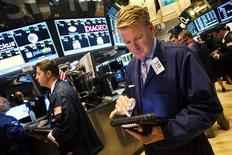 Traders work on the floor of the New York Stock Exchange in New York, August 1, 2013. REUTERS/Keith Bedford