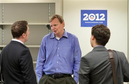 Campaign manager Jim Messina speaks with the media as he walks through President Barack Obama's new campaign headquarters in Chicago May 12, 2011. REUTERS/John Gress