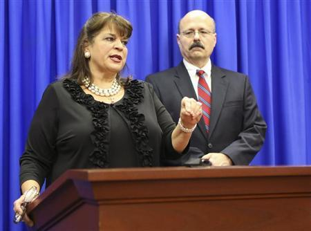 State Attorney Angela Corey and her assistant state attorney Bernie de la Rionda (R) address the media following the not guilty verdict for George Zimmerman in the 2012 shooting death of Trayvon Martin at the Seminole County Criminal Justice Center in Sanford, Florida, July 13, 2013. REUTERS/Gary W. Green/Pool