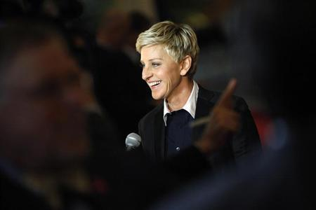 Ellen DeGeneres smiles as she talks to a reporter while arriving for the Mark Twain Prize ceremony in Washington, October 22, 2012. REUTERS/Jonathan Ernst