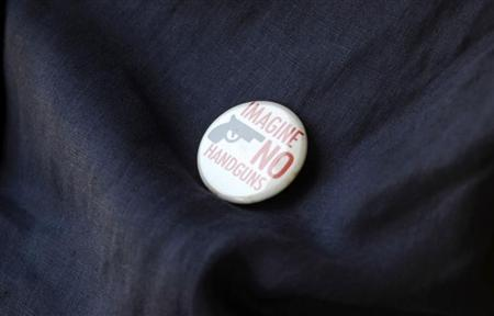 An opponent of Florida's 'Stand Your Ground' law wears a button against handguns outside a meeting o the law in Longwood, Florida, June 12, 2012. REUTERS/David Manning