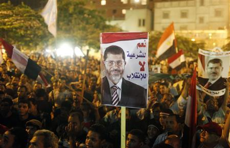 Members of the Muslim Brotherhood and supporters of deposed Egyptian President Mohamed Mursi shout slogans and hold up posters during a rally marching back towards Rabaa al-Adawiya Square where they are camping, in Cairo August 2, 2013. The poster reads, ''Yes to legitimacy, no to the coup.'' REUTERS/Asmaa Waguih