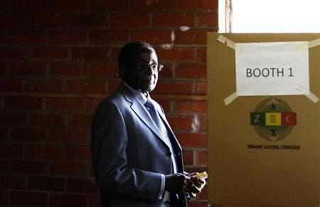 Zimbabwe's President Robert Mugabe looks on before casting his vote in Highfields outside Harare July 31, 2013. REUTERS/Siphiwe Sibeko