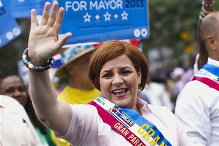 New York mayoral candidate Christine Quinn waves to the crowd while attending the annual Dominican Day Parade in the Bronx, New York July 28, 2013. REUTERS/Eduardo Munoz