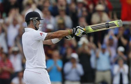 England's Kevin Pietersen celebrates after reaching his century during the third day of the third Ashes test cricket match against Australia at Old Trafford cricket ground in Manchester, northern England August 3, 2013. REUTERS/Phil Noble