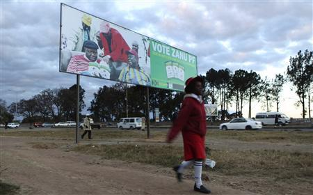 A child walks past an election billboard for Zimbabwe's President Robert Mugabe's ZANU-PF party in the capital Harare August 2,2013. REUTERS/Philimon Bulawayo