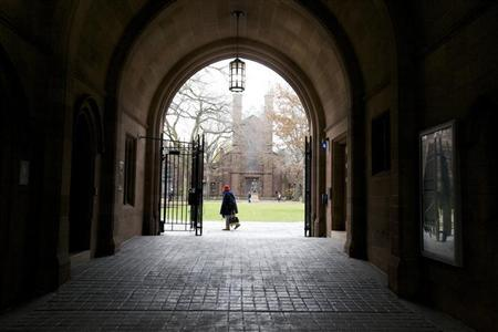 A woman walks through the Old Campus at Yale University in New Haven, Connecticut, November 28, 2012. REUTERS/Michelle McLoughlin