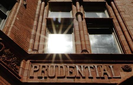 The sun reflects in a window above the raised lettering of the former Prudential Assurance building in the City of London May 28, 2010. REUTERS/Luke MacGregor