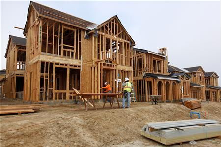Construction workers build single family homes in San Diego, California March 25, 2013. REUTERS/Mike Blake