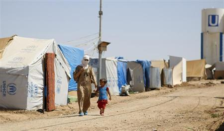 Syrian refugees walk at the Domiz refugee camp in the northern Iraqi of province Dohuk July 3, 2013. REUTERS/Ahmad Mousa