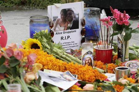 A makeshift memorial stands on the Venice Beach boardwalk for Alice Gruppioni, a tourist on her honeymoon from Bologna, Italy, who was killed Saturday when a motorist drove a car through the boardwalk in Los Angeles, California, August 5, 2013. REUTERS/Jonathan Alcorn