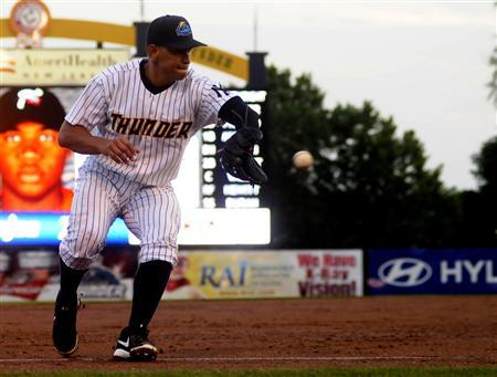 New York Yankee Alex Rodriguez fields a ground ball as he plays for the Trenton Thunder in the third inning of their rehab minor league baseball game against the Reading Fightin Phils in Trenton, New Jersey, August 3, 2013. Major League Baseball is no longer negotiating a settlement with Rodriguez and could hand him a 214-game suspension, the New York Daily News reported on Saturday. REUTERS/Scott Anderson