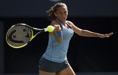 Roberta Vinci of Italy returns a shot to Julia Goerges of Germany during their first round match at the Rogers Cup tennis tournament in Toronto, August 5, 2013. REUTERS/Mark Blinch