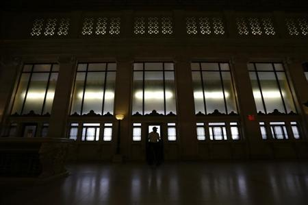 A guard passes a doorway in the foyer of the old Post Office building in Washington, D.C. July 10, 2012. REUTERS/Kevin Lamarque