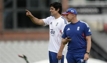 England's captain Alastair Cook points as he stands with coach Andy Flower (R) during a training session before Thursday's third Ashes cricket test match against Australia at Old Trafford cricket ground in Manchester July 30, 2013. REUTERS/Philip Brown