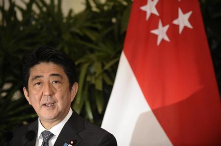 Japan's Prime Minister Shinzo Abe speaks during a joint news conference after meeting with his Singaporean counterpart Lee Hsien Loong (unseen) at the Istana in Singapore July 26, 2013. REUTERS/Timothy Sim