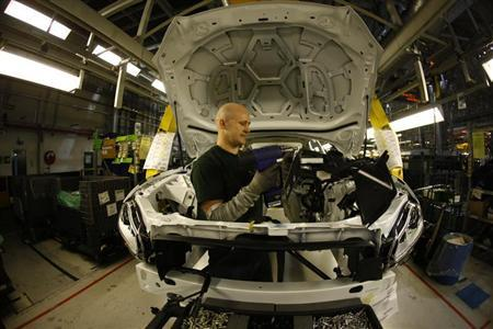 Staff work on the Jaguar XJ production line at their Castle Bromwich Assembly Plant in Birmingham November 29, 2011. REUTERS/Eddie Keogh
