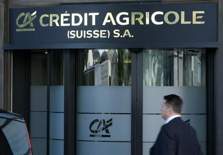 A man walks past the entrance of the Credit Agricole Bank building in Geneva August 5, 2008. REUTERS/Denis Balibouse