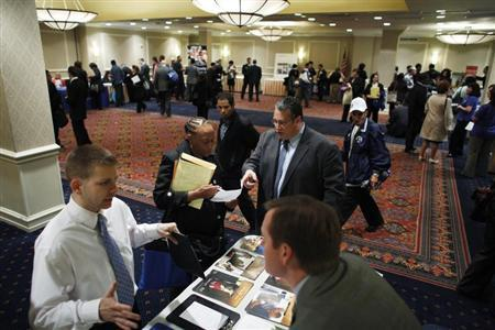 Job seekers speak with with job recruiters while they attend the Coast to Coast job fair in New York, May 7, 2012. REUTERS/Eduardo Munoz