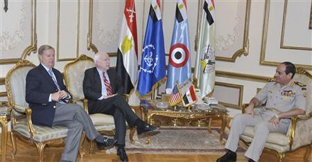 Egypt's Armed Forces General Abdel Fattah al-Sisi (R) meets with U.S. Senators' John McCain (C) and Lindsey Graham at the Ministry of Defense in Cairo in this August 6, 2013 handout picture provided by the Ministry of Defense. REUTERS/Ministry of Defense/Handout via Reuters