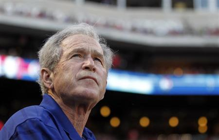 Former U.S. president George W. Bush watches before the start of the MLB American League baseball game between the Texas Rangers and the Chicago White Sox in Arlington, Texas April 30, 2013. REUTERS/Mike Stone