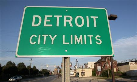 A 'Detroit City Limits' border sign is seen as traffic enters a westside neighborhood in Detroit, Michigan July 22, 2013. Picture taken July 22, 2013. REUTERS/ Rebecca Cook