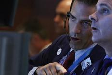 La Bourse de New York a fini en baisse de 0,60% mardi, l'indice Dow Jones des 30 industrielles cédant 93,85 points à 15.518,28, des données susceptibles de varier encore légèrement. /Photo prise le 6 août 2013/REUTERS/Brendan McDermid