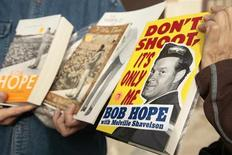 Books written by and about the late actor Bob Hope are among the items purchased during a garage sale at the actor's estate in the Toluca Lake neighborhood of Los Angeles, California December 8, 2012. REUTERS/Jason Redmond