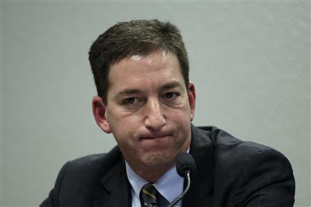 Glenn Greenwald, the American journalist who first published the documents leaked by former NSA contractor Edward Snowden, testifies before a Brazilian Congressional committee on NSA's surveillance programs, in Brasilia August 6, 2013. REUTERS/Ueslei Marcelino