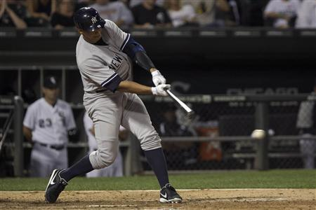 New York Yankee's Alex Rodriguez hits a single while playing the Chicago White Sox during the eighth inning of their American League MLB baseball game in Chicago, August 6, 2013. REUTERS/John Gress