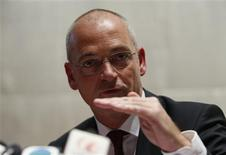 Fonterra Chief Executive Theo Spierings speaks at a news conference in Beijing August 5, 2013. REUTERS/Kim Kyung-Hoon