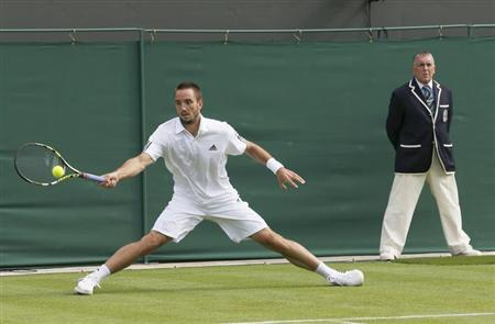 Viktor Troicki of Serbia hits a return to Janko Tipsarevic of Serbia in their men's singles tennis match at the Wimbledon Tennis Championships, in London June 24, 2013. REUTERS/Suzanne Plunkett