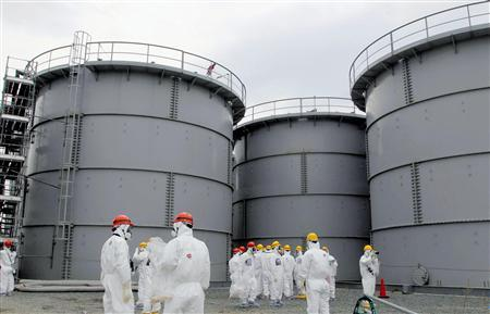 Tanks of radiation-contaminated water are seen at the Tokyo Electric Power Co (TEPCO)'s tsunami-crippled Fukushima Daiichi nuclear power plant in Fukushima prefecture, in this file photo released by Kyodo March 1, 2013. REUTERS/Kyodo/Files